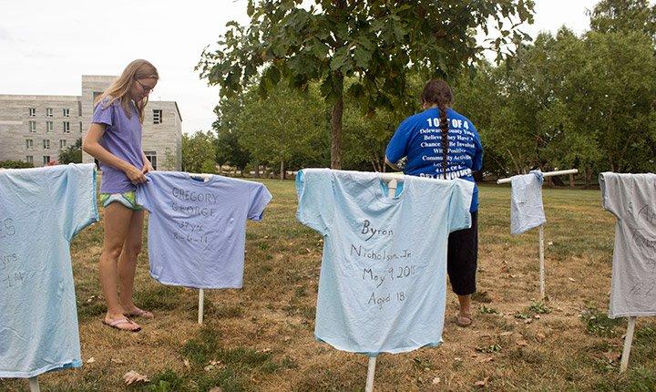 People hang t-shirts