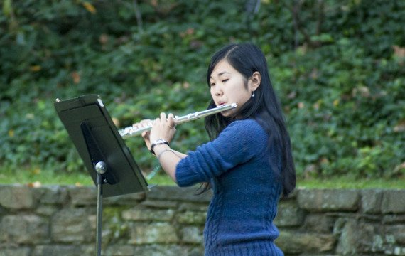 A flutist in the Swarthmore Wind Ensemble prepares for rehearsal in the Scott Amphitheater.