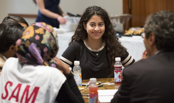 student at table