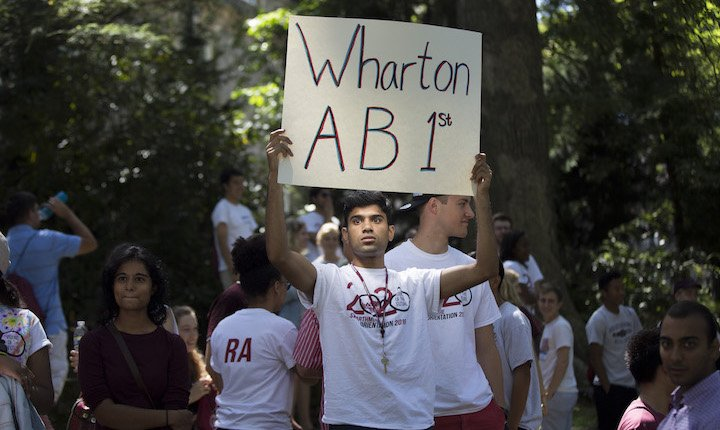 student with Wharton sign