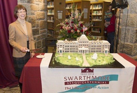 Rebecca Chopp cuts the cake