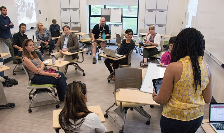 People sit in a newly renovated classroom