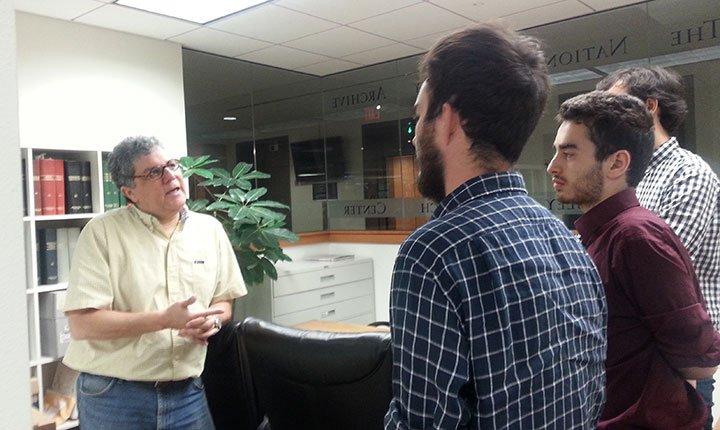 Carlos Osorio speaks to Brandon Conner '17, William Meyer '17, and Carlo Bruno '17