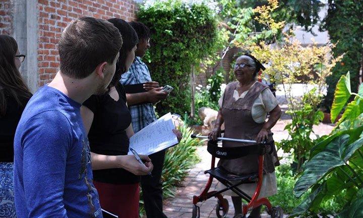 Students in garden with Josefina Antonio Ruiz