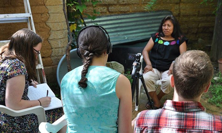 Students conducting an interview of Margarita Martinez