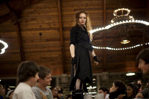 Bellatrix Lestrange (Naia Poyer '14) threatens a table of students with her wand