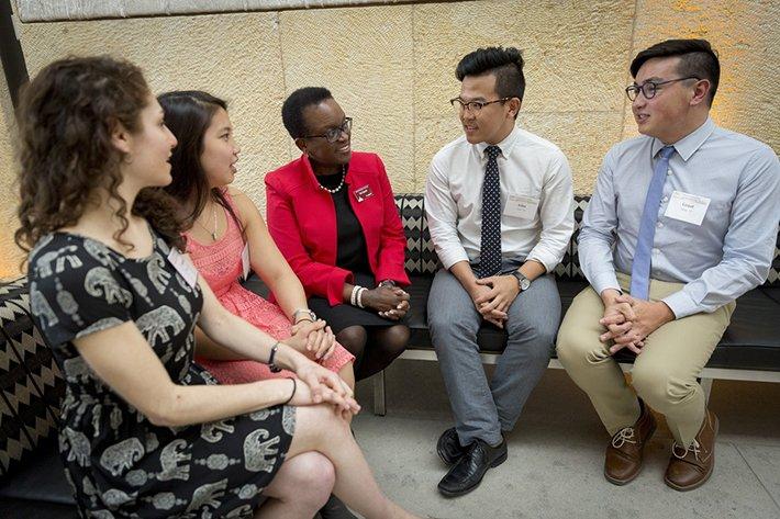 President Smith speaks with students in Philadelphia.