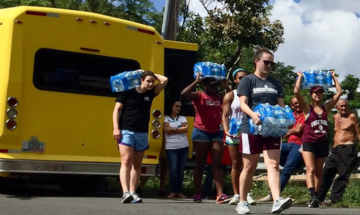 Members of the women's basketball team carry water