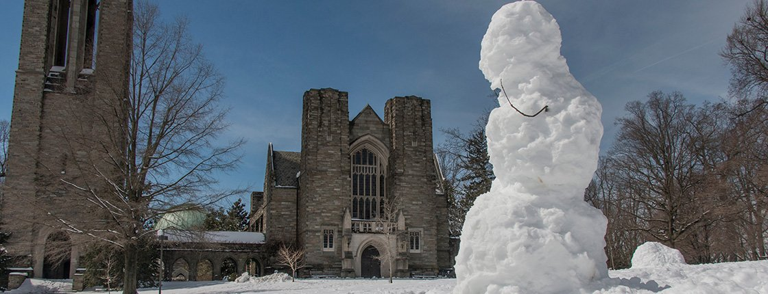 A snowman in front of Clothier.