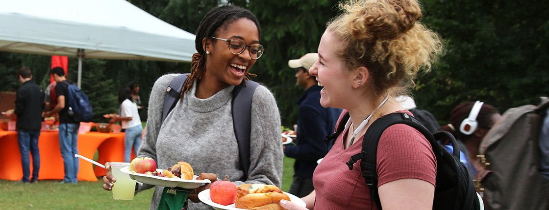Students enjoy food at community gathering
