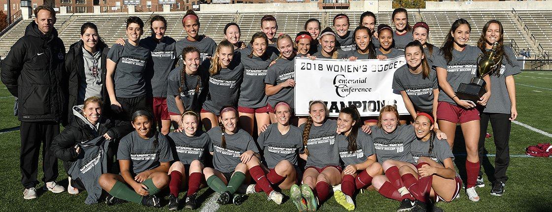 Women's soccer team with 2018 Centennial Conference banner