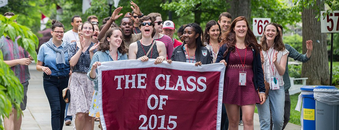 Members of the Class of 2015 gather behind their banner at Alumni Weekend 2017