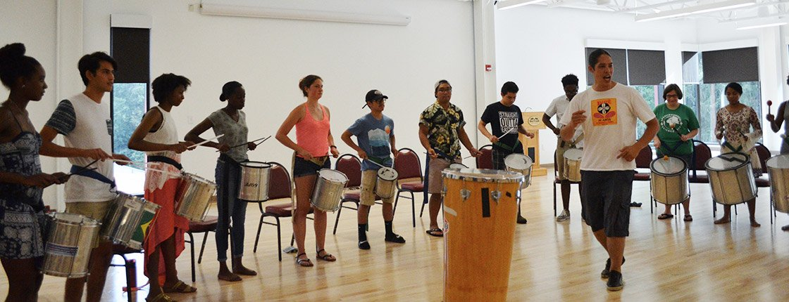 Students perform a drum circle
