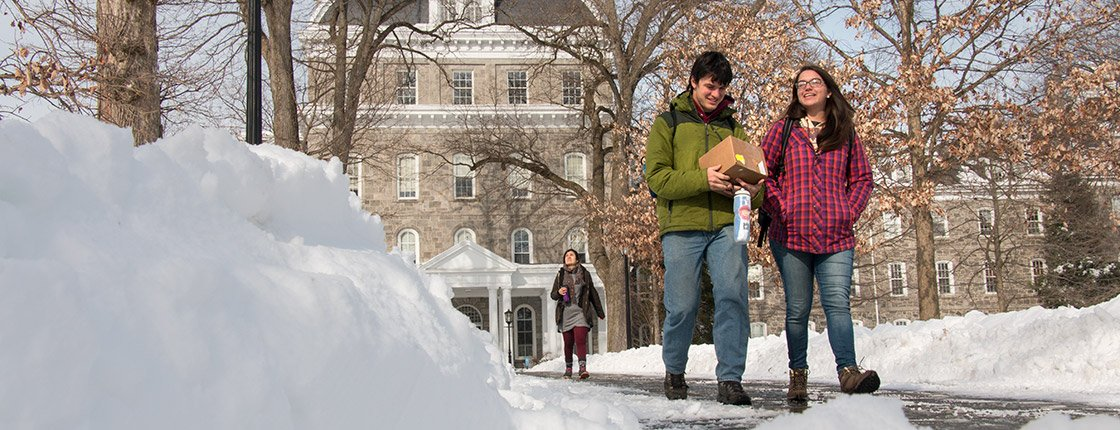 Students walk on a snow-covered campus