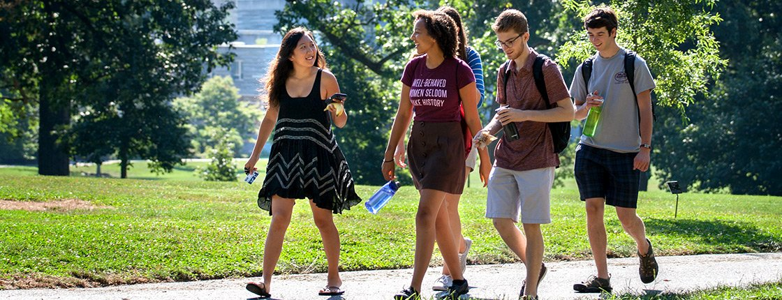 Four students walking