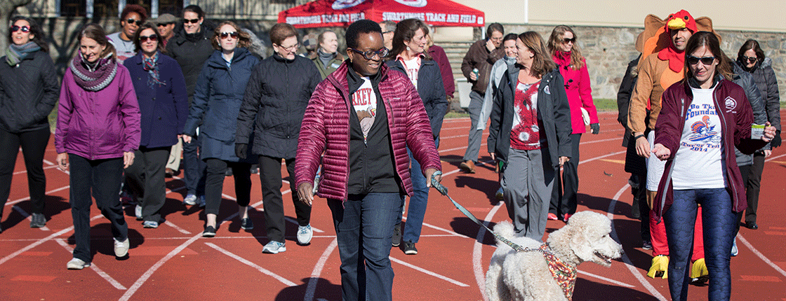 President Valerie Smith leads walkers for the Turkey Trot