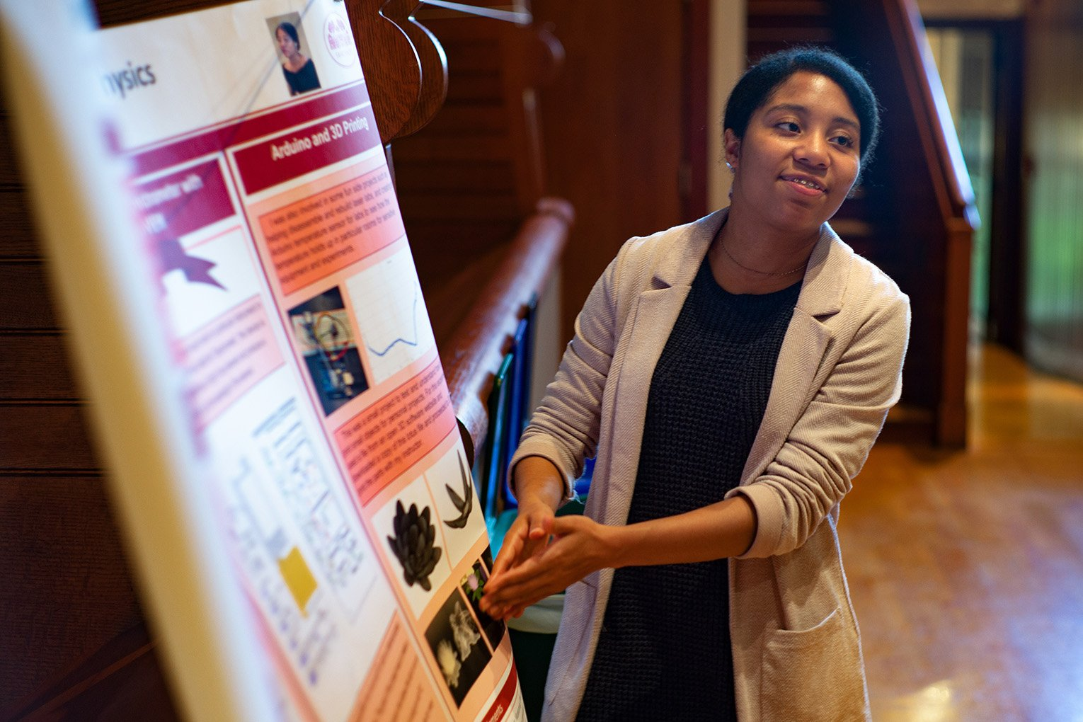Student presents poster during session in Upper Tarble