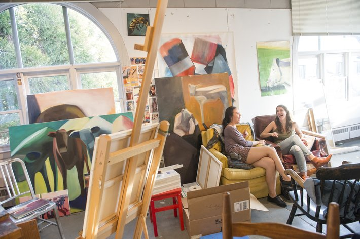 Two students talking in art studio