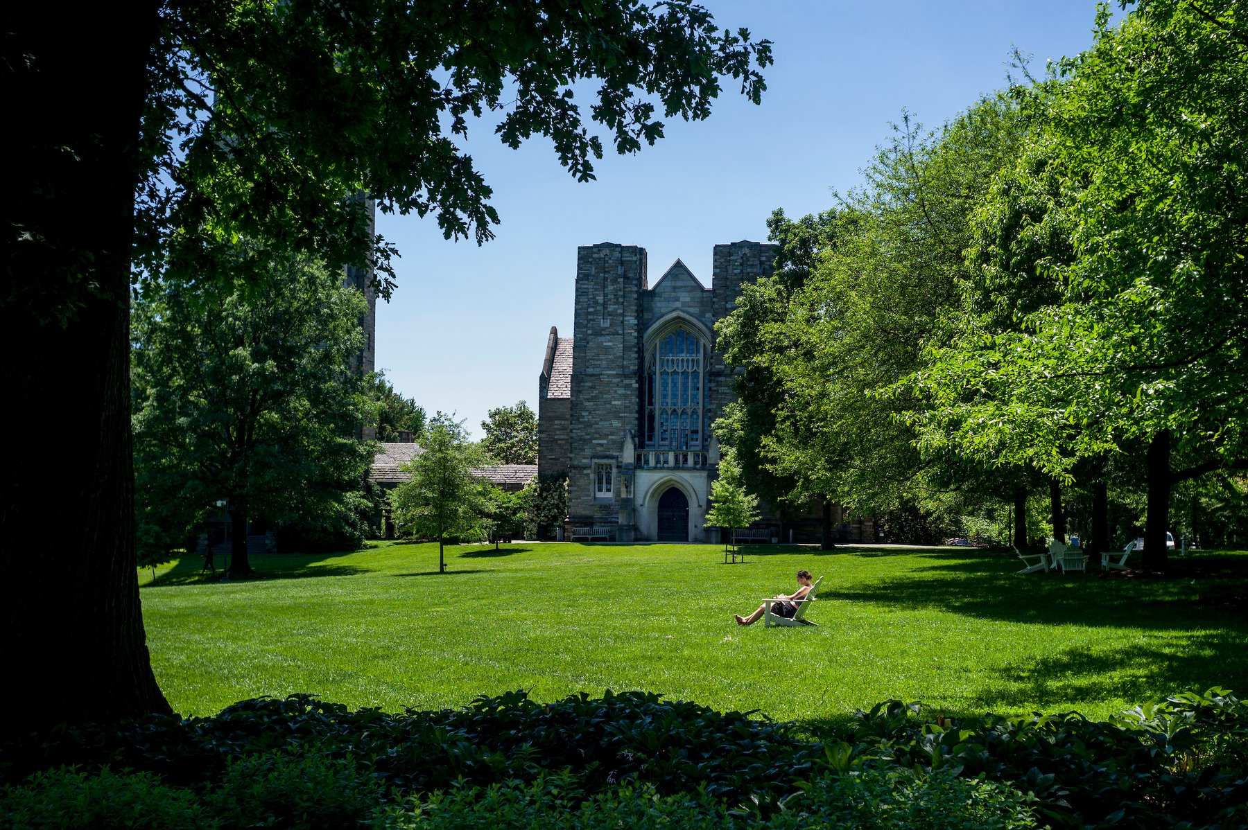 A woman reading on Parrish Beach on the campus of Swarthmore College