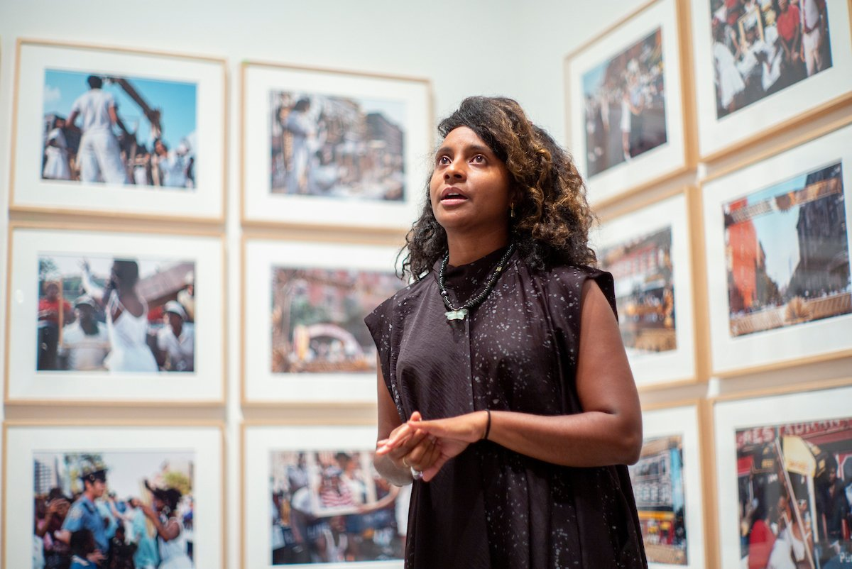 "Zoe Whitley '01 speaks in front of photographs displayed at ""Soul of a Nation: Art in the Age of Black Power"" exhibit at the Brooklyn Museum in September 2018."