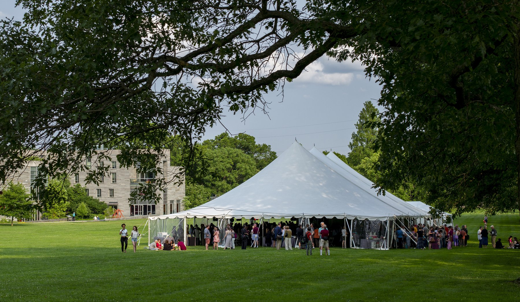 Alumni under white tent on Mertz lawn