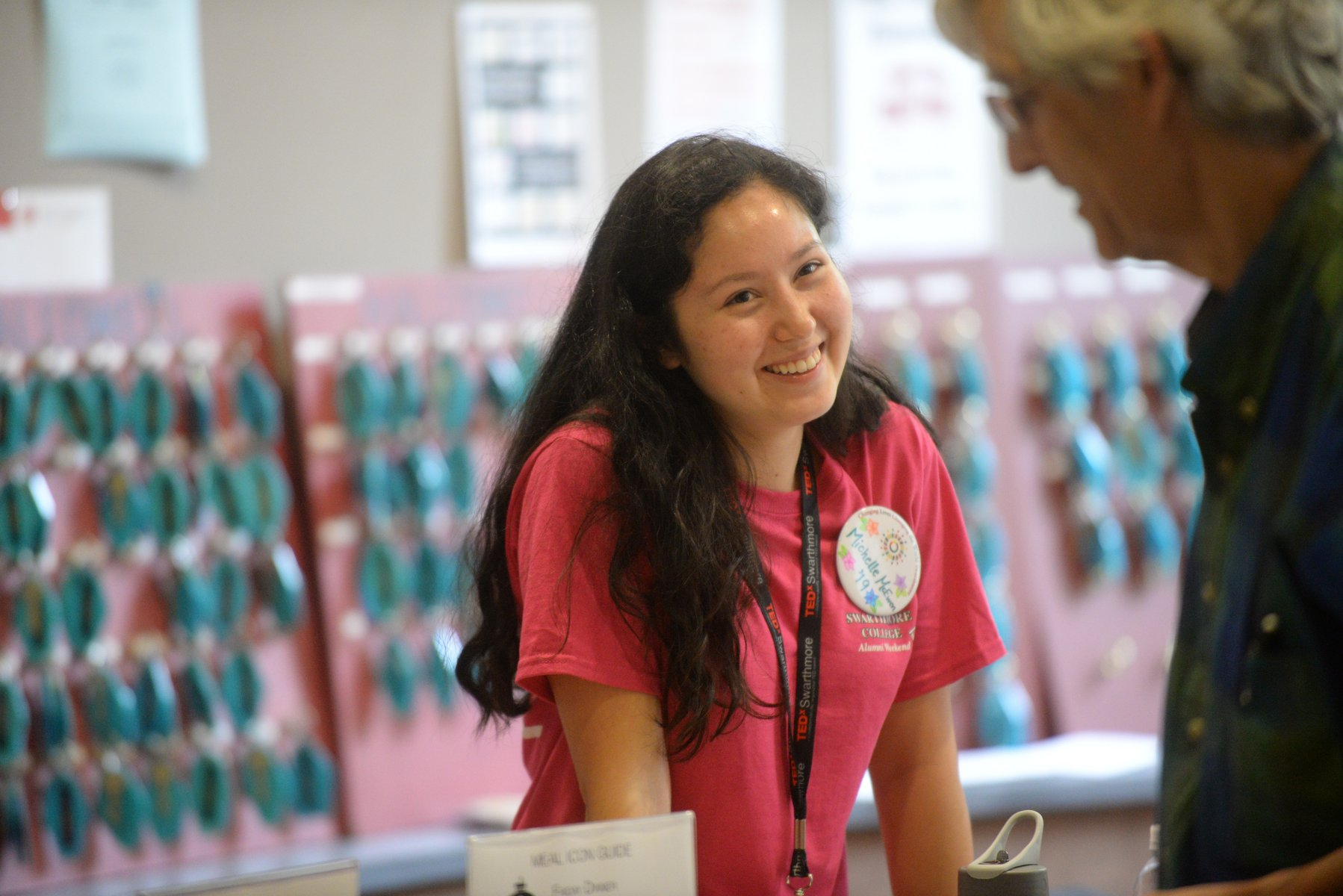 A student worker checks in alumni guests
