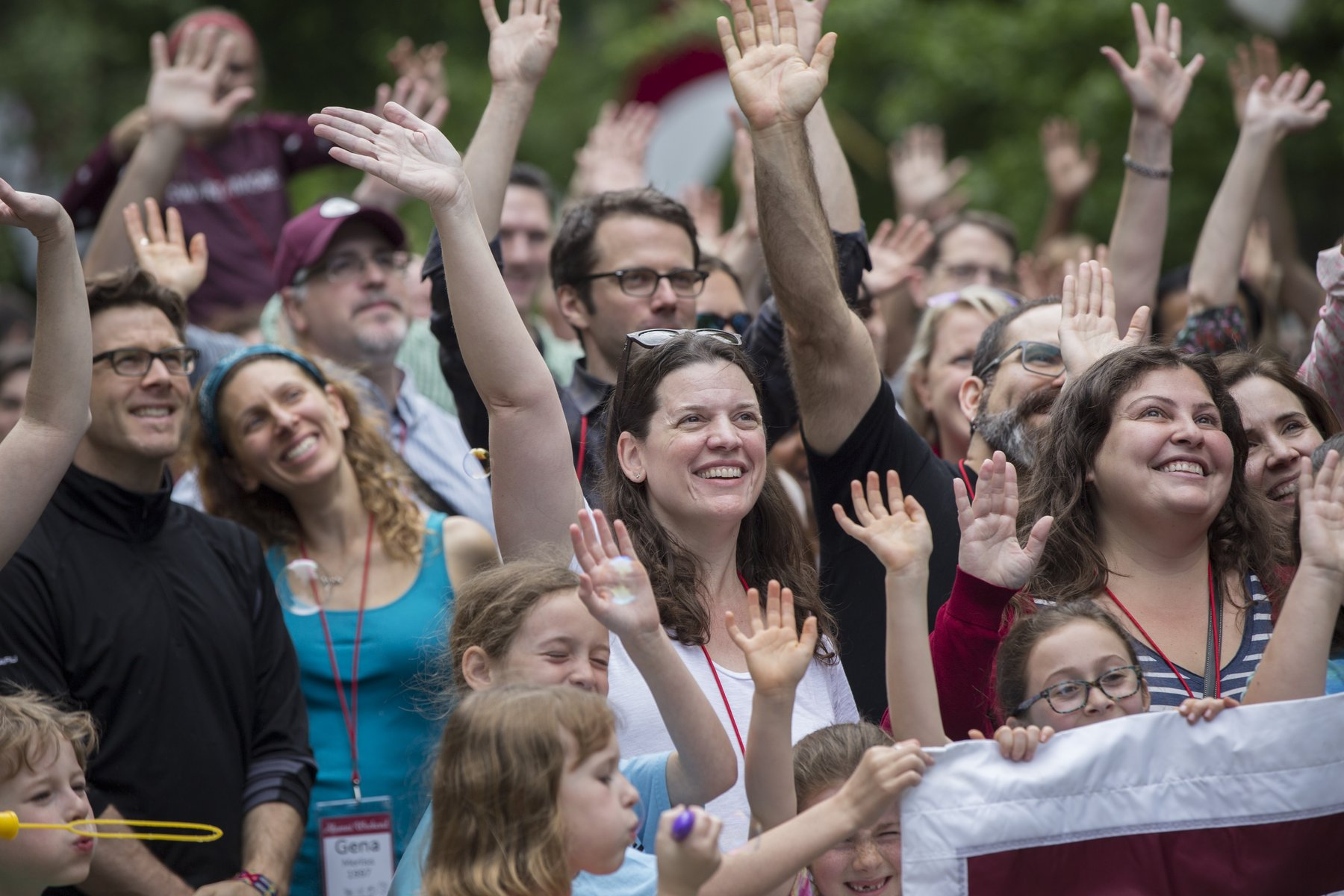 Alumni wave during the annual Parade of Classes