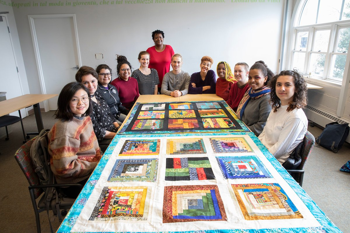 Students from the Black Art: Quilting as History and Culture, with their completed quilts.