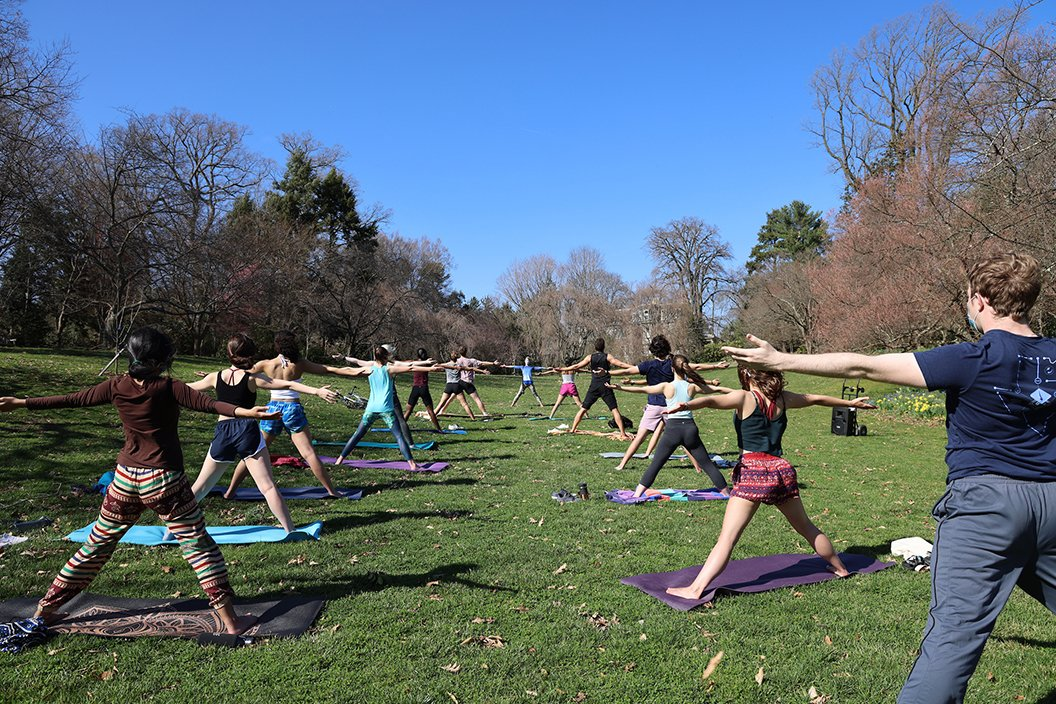 Students practice yoga outdoors