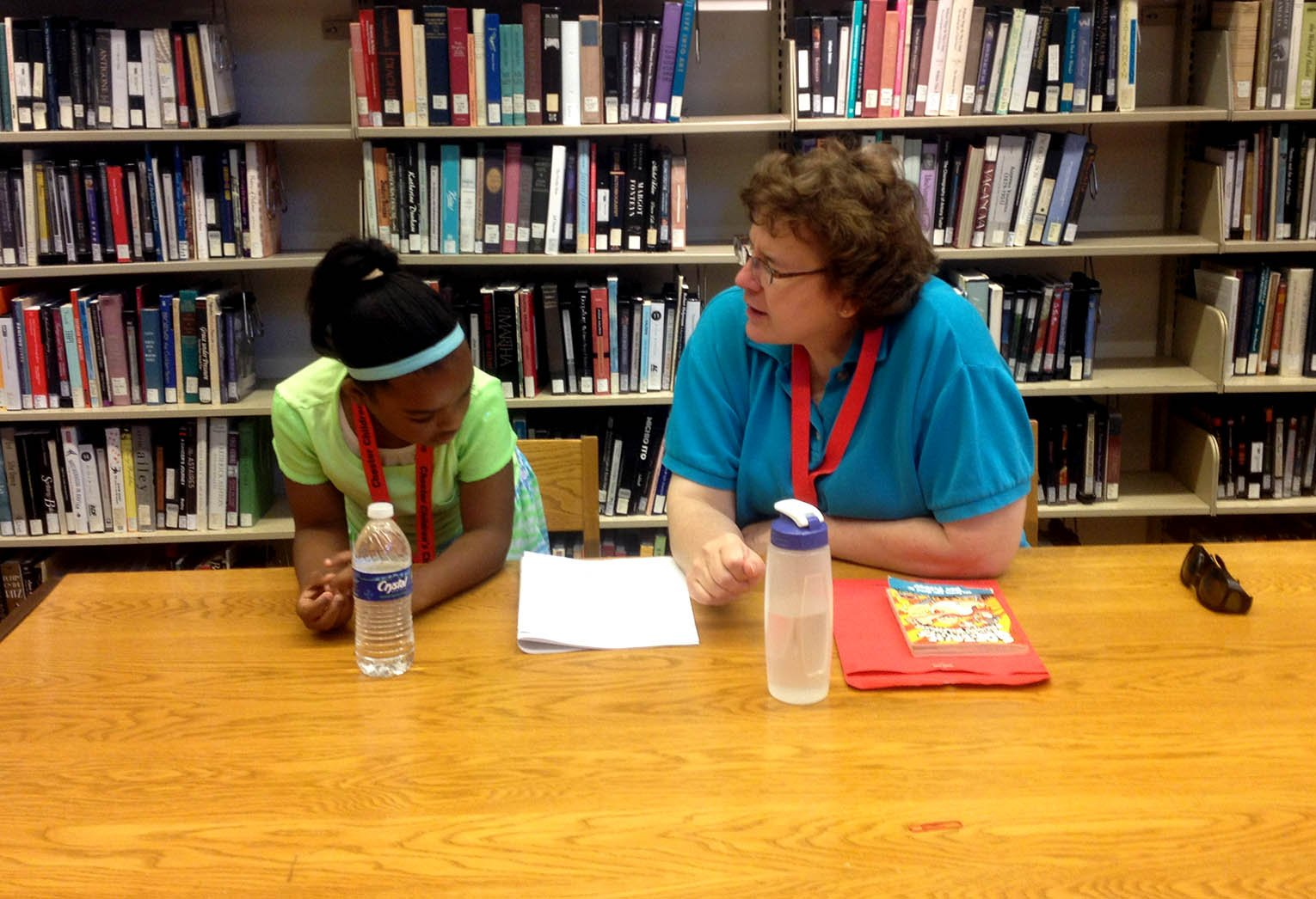 volunteer helping a student