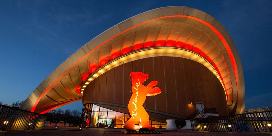 Fisheye-lens photograph of the Berlinale theater, lit up against a twilight sky