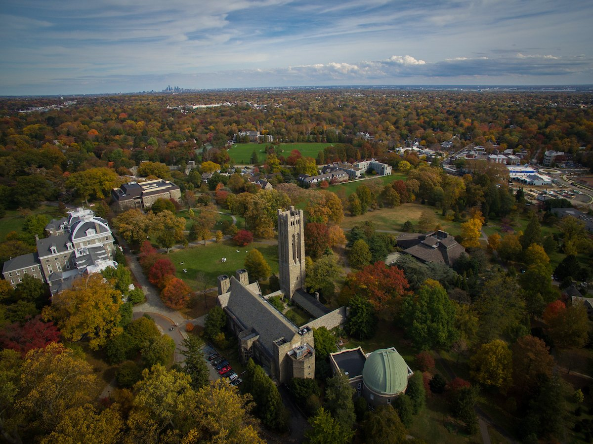 Aerial drone photography of the campus displaying the fall foilage and skyline