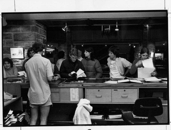 historical photo of students in line at the front desk of McCabe shortly after it opened around 1970