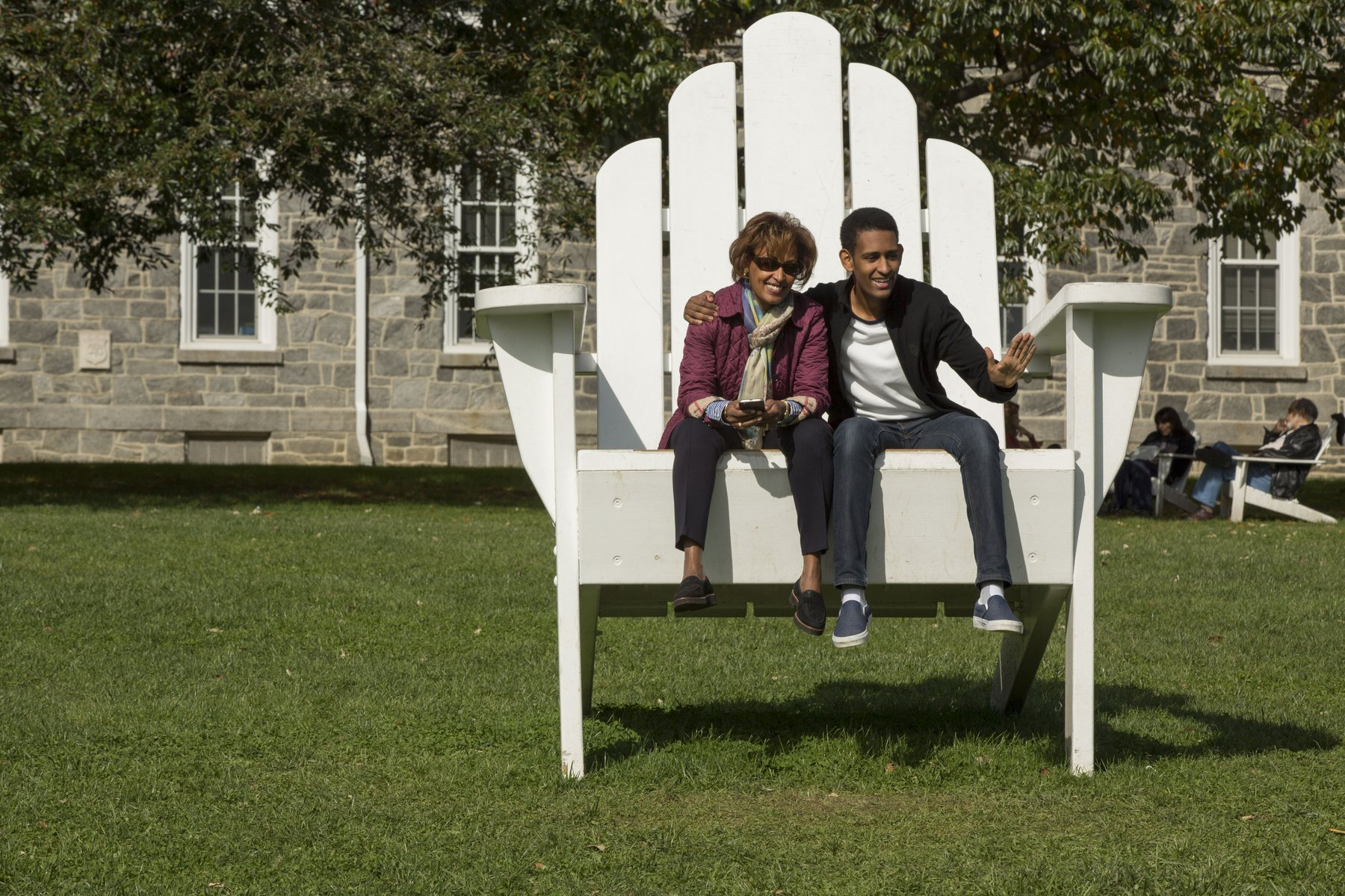 A parent and student sit together on the Big Chair