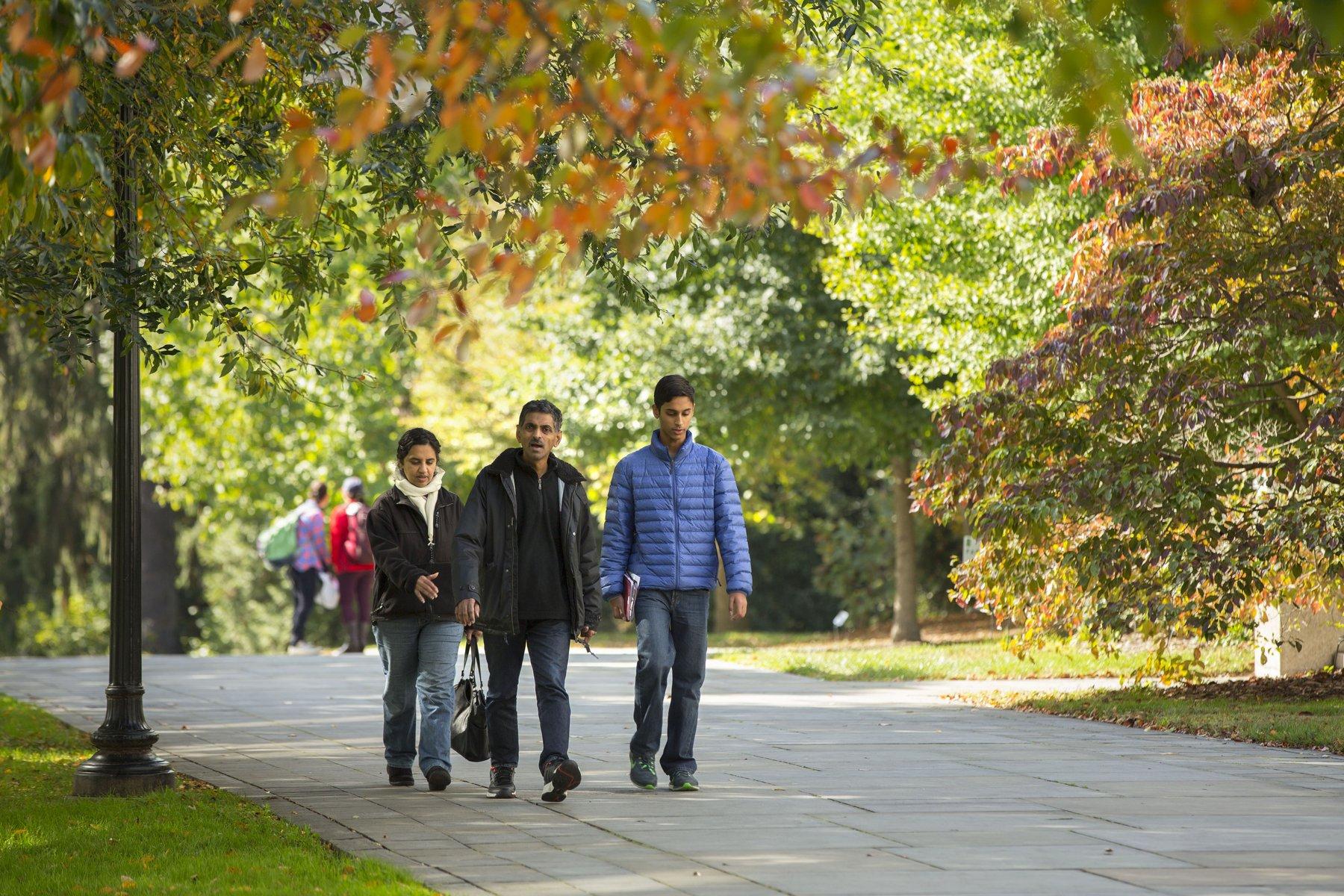 A family walks through campus