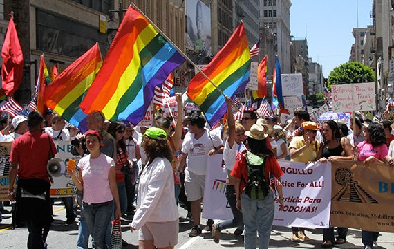 Sager Internship - image of GBLT march with rainbow flags