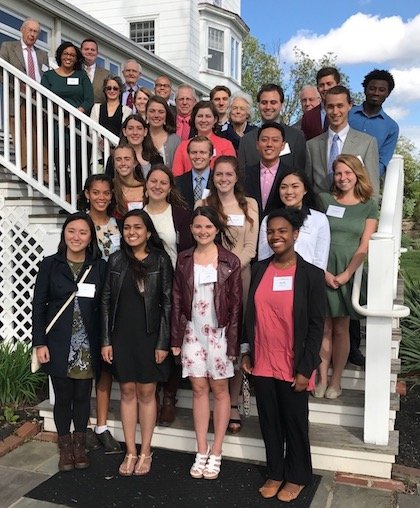 Smiling McCabe scholars pose for a photo on the steps of the Corinthian Yacht Club.