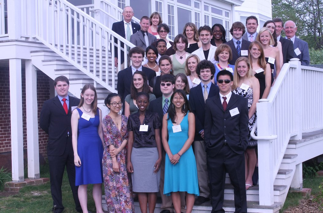 McCabe Scholars and Alumni pose on the steps of the Corinthian Yacht Club
