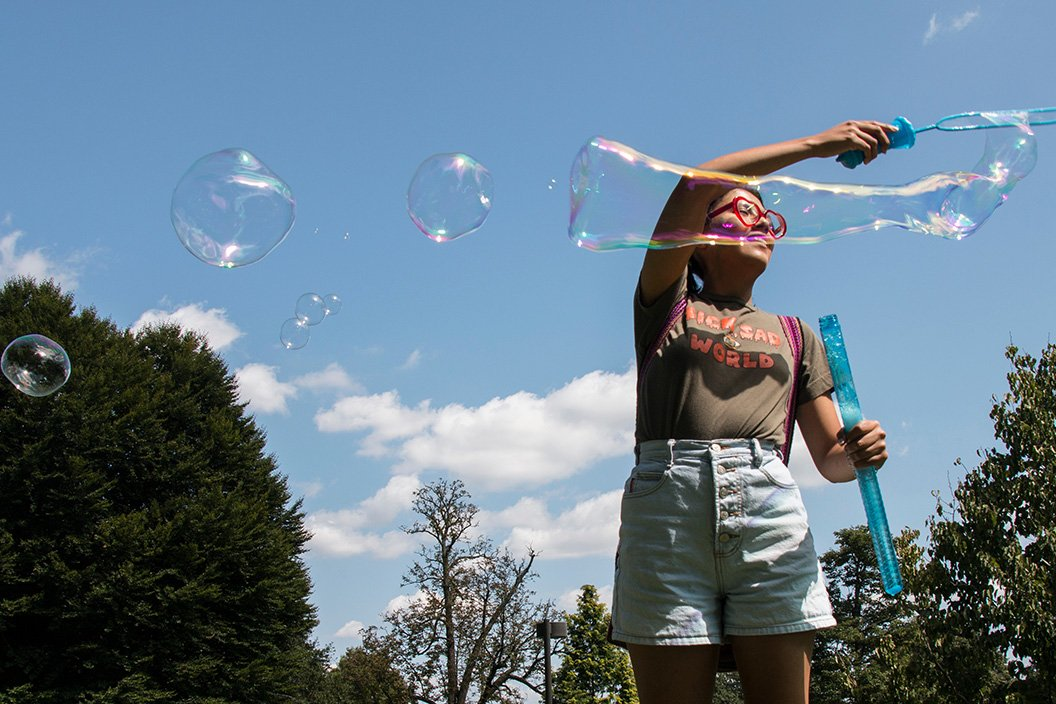 Student blows bubbles on Parrish Beach