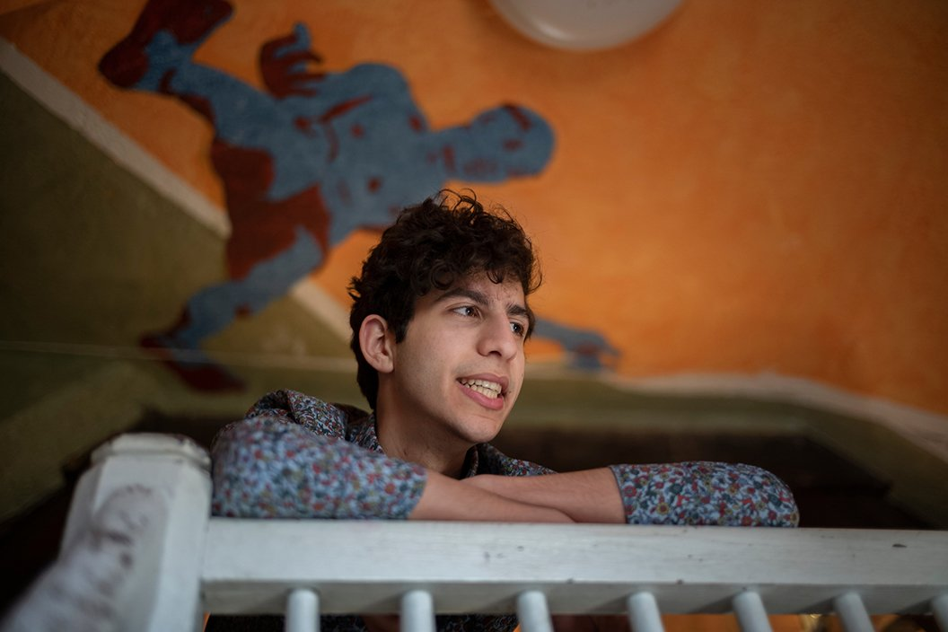 Fouad Dakwar '22 rests arms on railing of balcony
