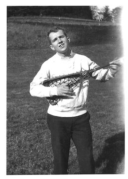 James Michener '29 holding a lacrosse stick like a guitar