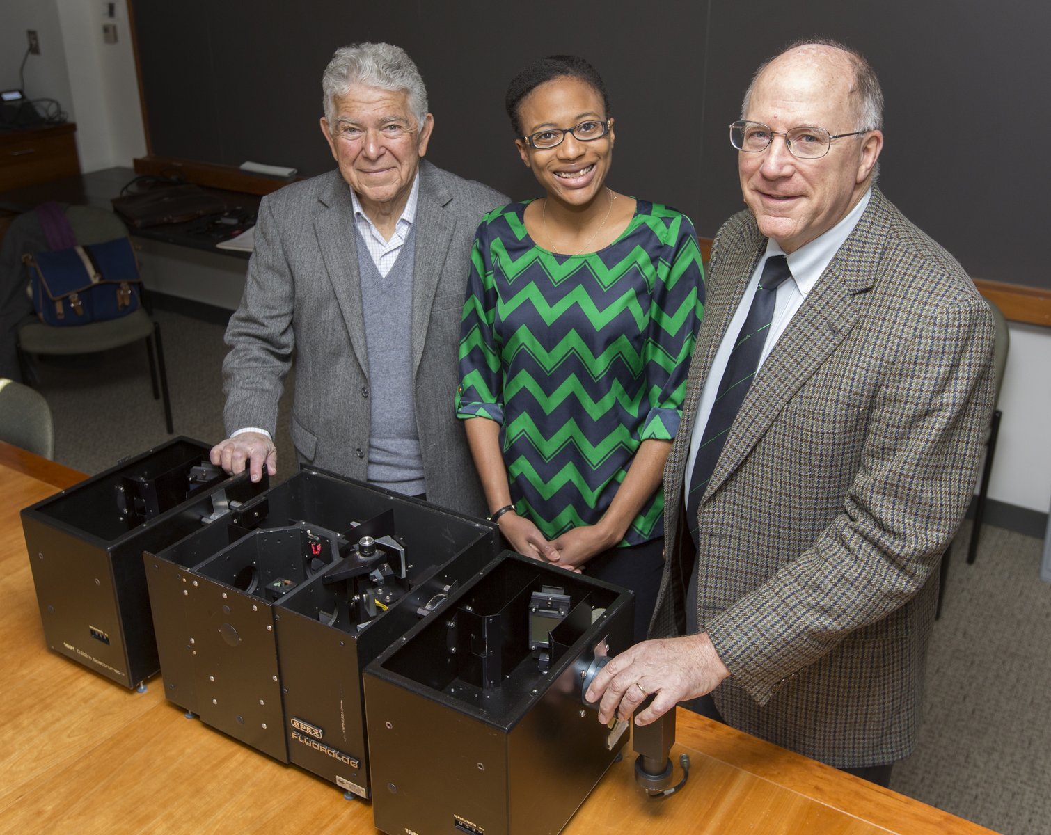 Bob Pasternack, Stephanie Lampkins of the Chemical Heritage Foundation, and Peter Collings with the historically significant SPEX Fluorolog Spectrometer.