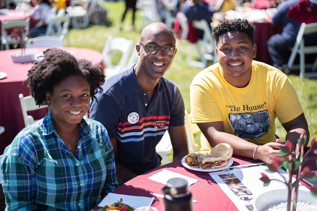 Students sit with professor at Swarthmore Fall Gathering celebration of Black Excellence