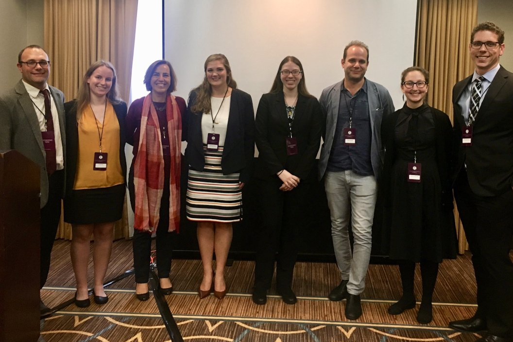 Karina Cooper '20 (fourth from right), Rebecca Posner-Hess '21 (second from right), and Associate Professor of Classics Jeremy Lefkowitz (third from right) at the conference of the Classical Association of the Atlantic States (CAAS)