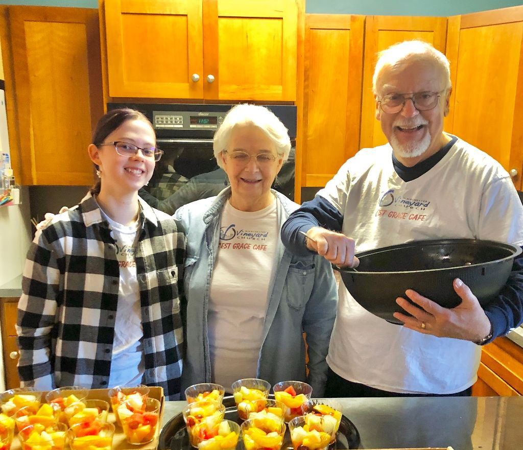 Rod '67 and Dorothy Woods Chronister '66 prepare food in the kitchen