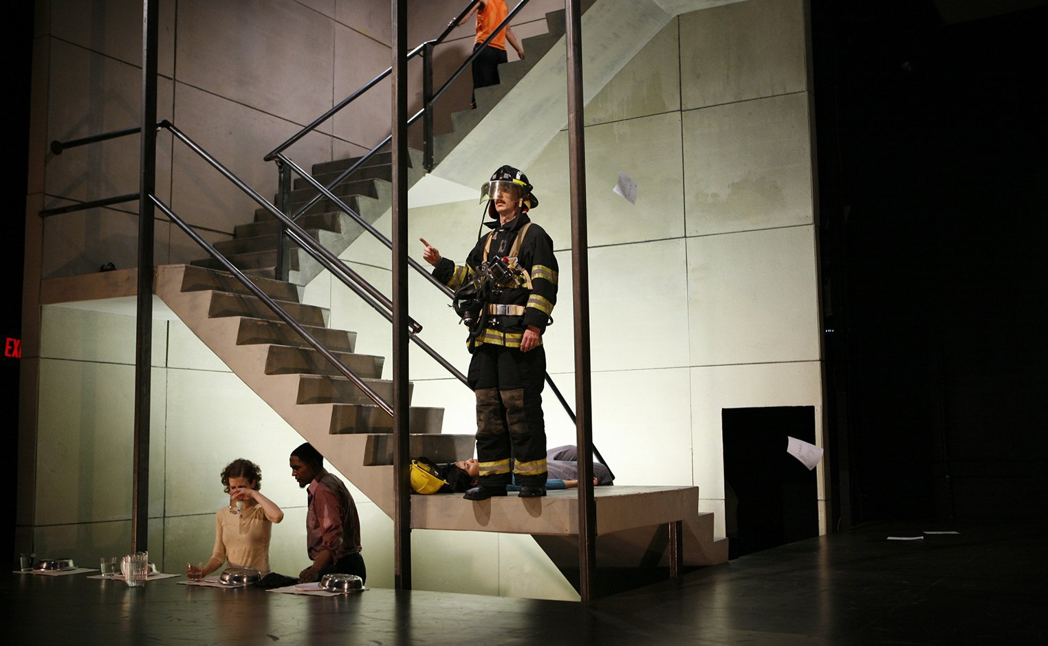 Person dressed as firefighter stands in stairwell