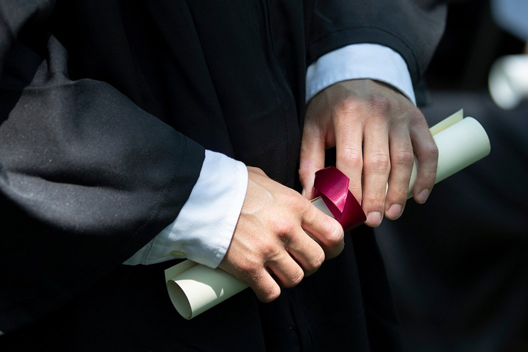 Diploma in hands of student