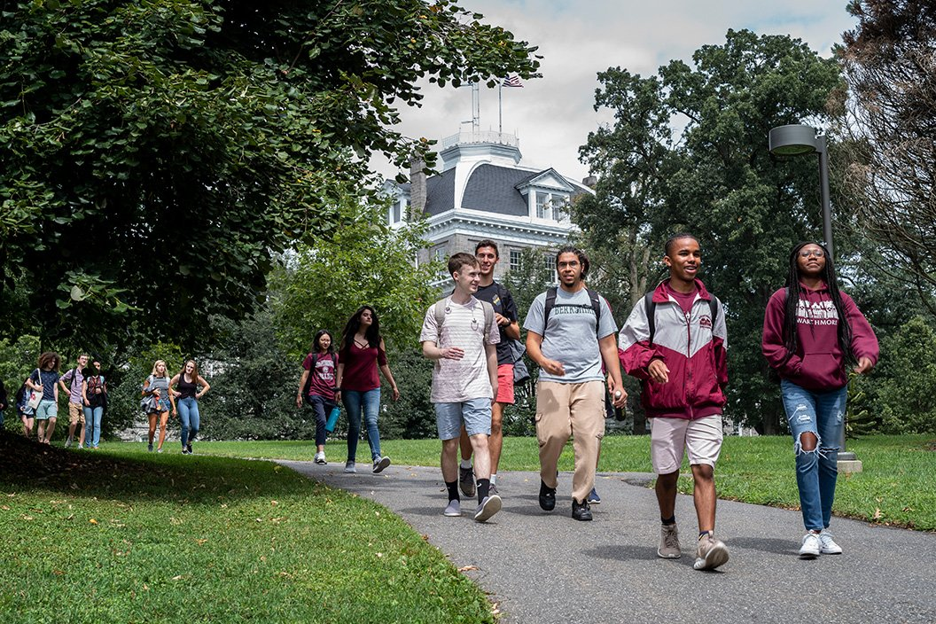Students walk down path with Parrish in background