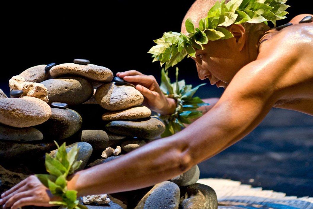 Man stacks stones for exhibit