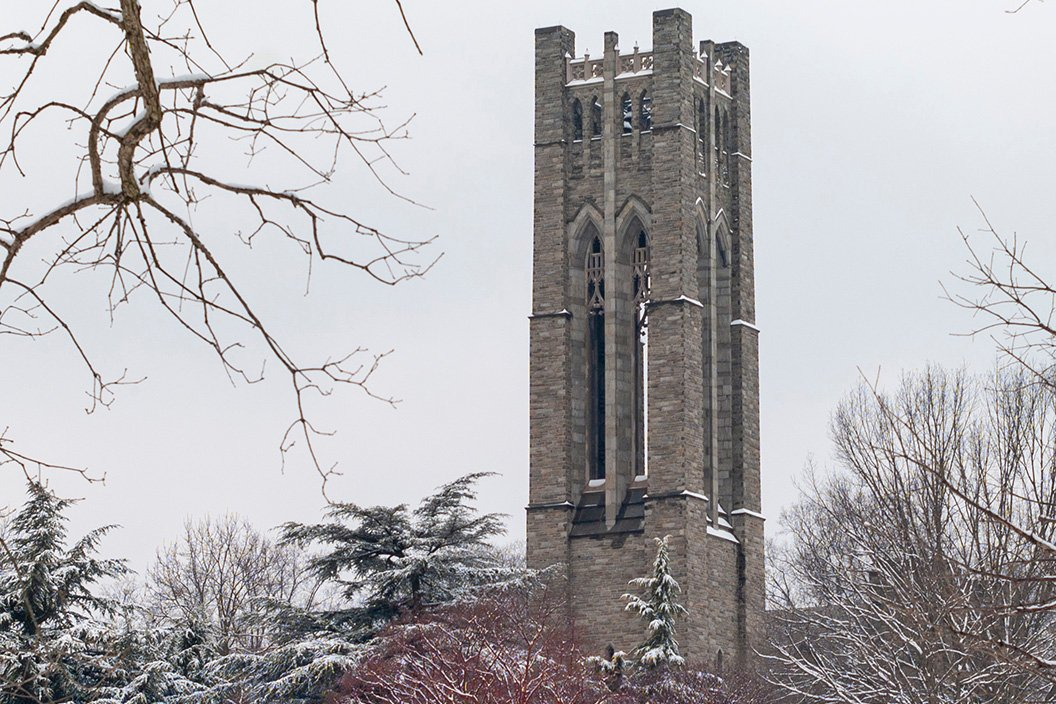 Clothier tower behind trees in winter